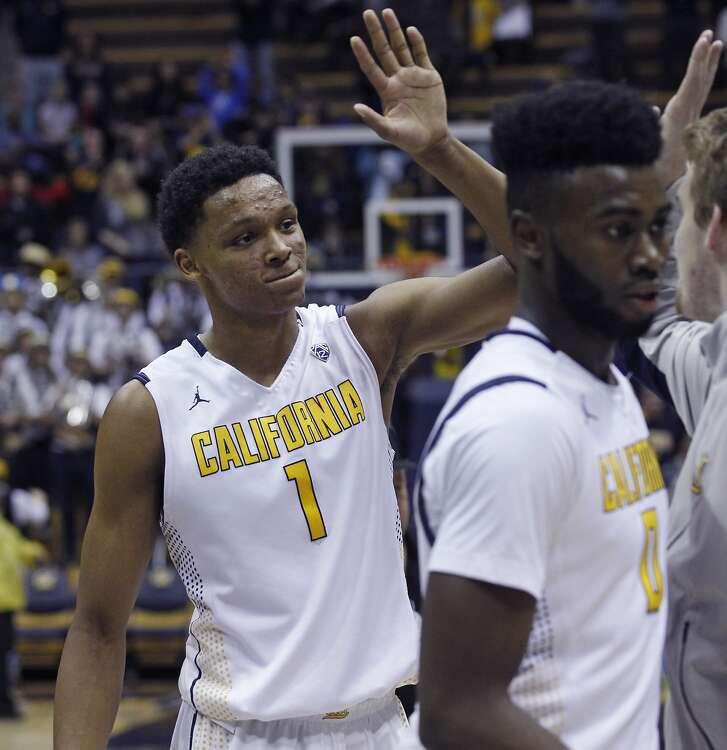 California's Ivan Rabb (1) celebrates with teammates after California beat Utah 71-58  in an NCAA basketball game, Sunday, Jan. 3, 2016, in Berkeley, Calif.  Jaylen Brown is in the foreground. (AP Photo/George Nikitin)