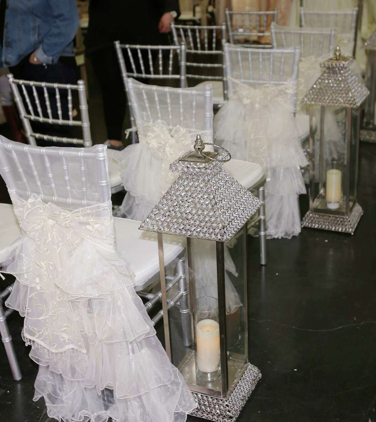 """Wedding-chair dresses : Apparently it's not enough for a bride to force her BFFs, cousins, and future sisters-in-law to wear a unflattering, impractical frocks on the big day. Ultra-feminine type are saying """"I do"""" to gowns for their ceremony chairs, too."""