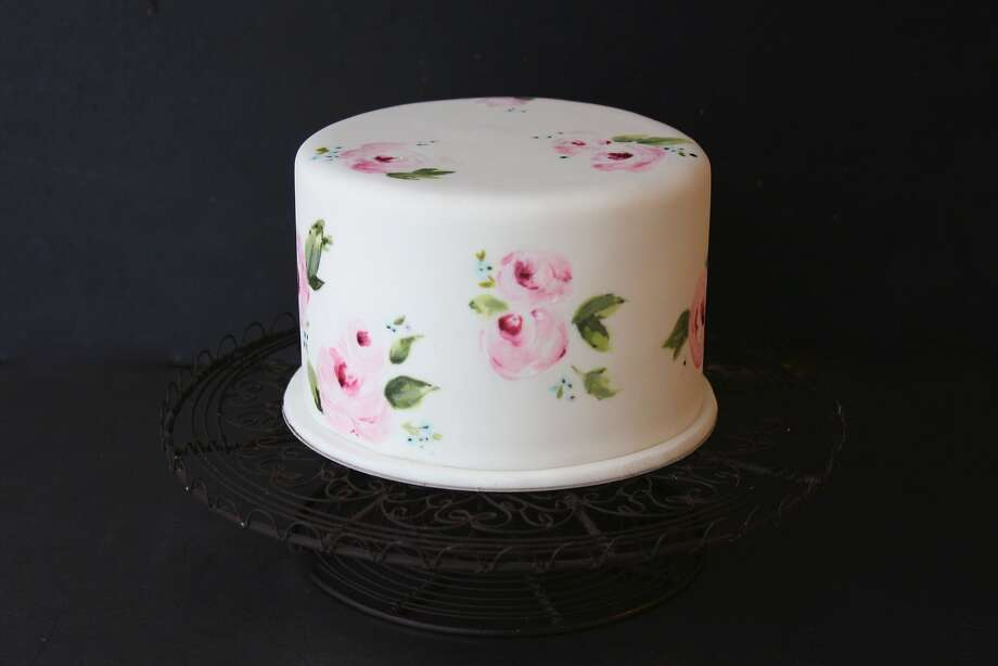 Krista Juracek, founder of Sainte G cakes, is an art major who bakes and decorates all of her cakes by herself. She likes to paint on the fondant icing of her cakes, creating sometimes sentimental and delicate designs like the one pictured here. www.sainteg.com