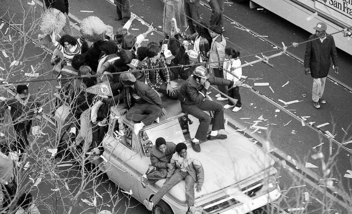 Fans celebrating the 49ers Super Bowl XVI win pile in an old truck on Market Street on Jan. 25, 1982.