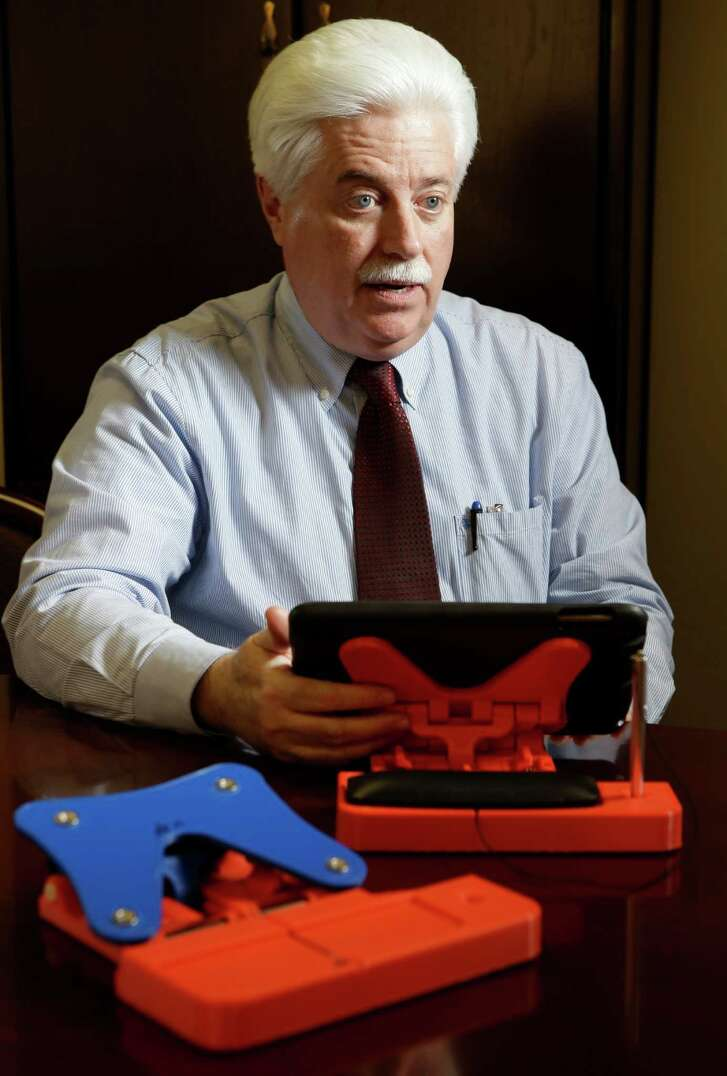 Stan Stanart, Harris County County Clerk, talks about the prototypes of a swiveling iPad stand that will hold an electronic poll book at polling sites shown in his office at 201 Caroline Wednesday, Jan. 13, 2016, in Houston.