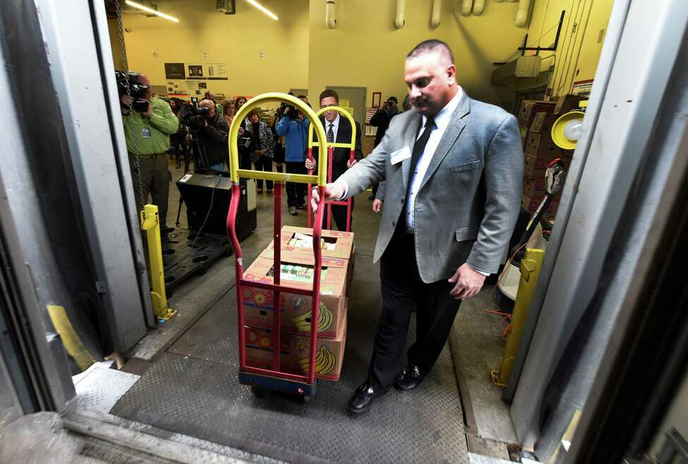 Pat Iannotti, director of Shrink Administration for Price Chopper moves boxes of food to a waiting Regional Food Bank Truck after the announcement of the EPA's Food Recovery Challenge Program Thursday afternoon, Jan. 14, 2016, at the Price Chopper on Central Ave. in Colonie, N.Y. (Skip Dickstein/Times Union)