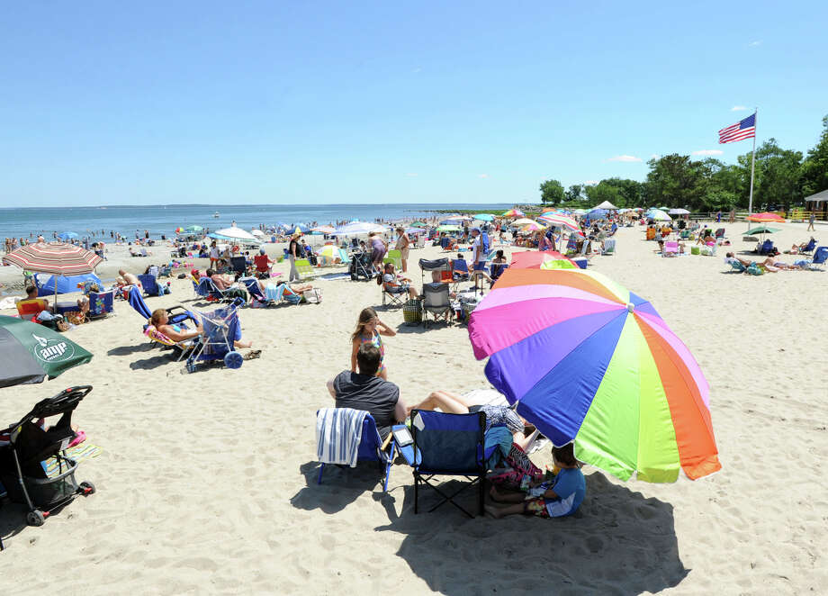 A crowded Greenwich Point beach in the summer. The town has raised fees to help cut down on too many visitors. Photo: Bob Luckey / Bob Luckey / Greenwich Time