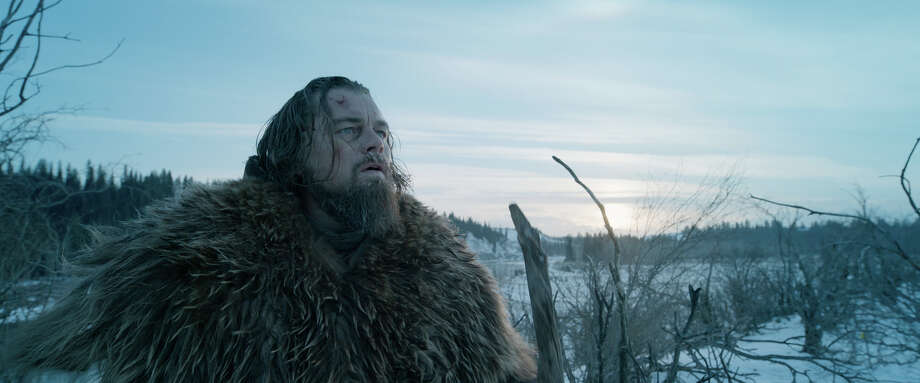 """This photo provided by Twentieth Century Fox shows, Leonardo DiCaprio in a scene from the film, """"The Revenant."""" DiCaprio and director Alejandro Gonzalez Inarritu talked to Associated Press about braving the extremes to create the survival and revenge epic """"The Revenant."""" The movie opens in U.S. theaters on Jan. 8, 2016. (Twentieth Century Fox via AP) Photo: HONS / Twentieth Century Fox"""