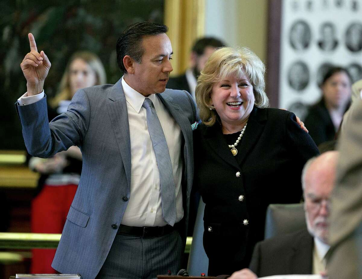 Senator Jane Nelson is congratulated by Senator Carlos Uresti during passage of SB1 at the Capitol in Austin, Texas on Friday, May 29, 2015. On a 30-1 Senate vote, the only bill lawmakers must pass during the 140-day session was approved Friday. The House later endorsed it 115-33. (Deborah Cannon/Austin American-Statesman via AP)