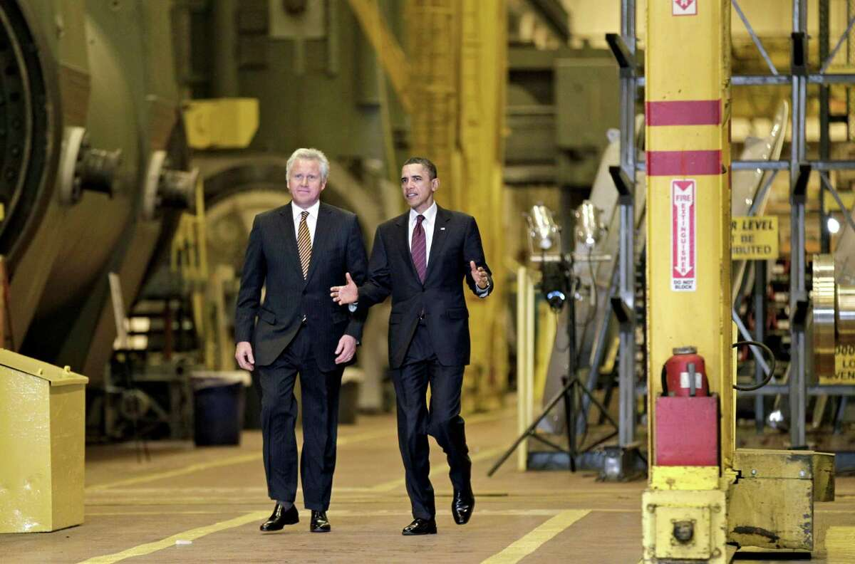 In this file photo from 2011, President Barack Obama and GE CEO Jeffrey Immelt visits the birthplace of the General Electric Co. to showcase a new GE deal with India and to announce a restructured presidential advisory board in Schenectady, N.Y.