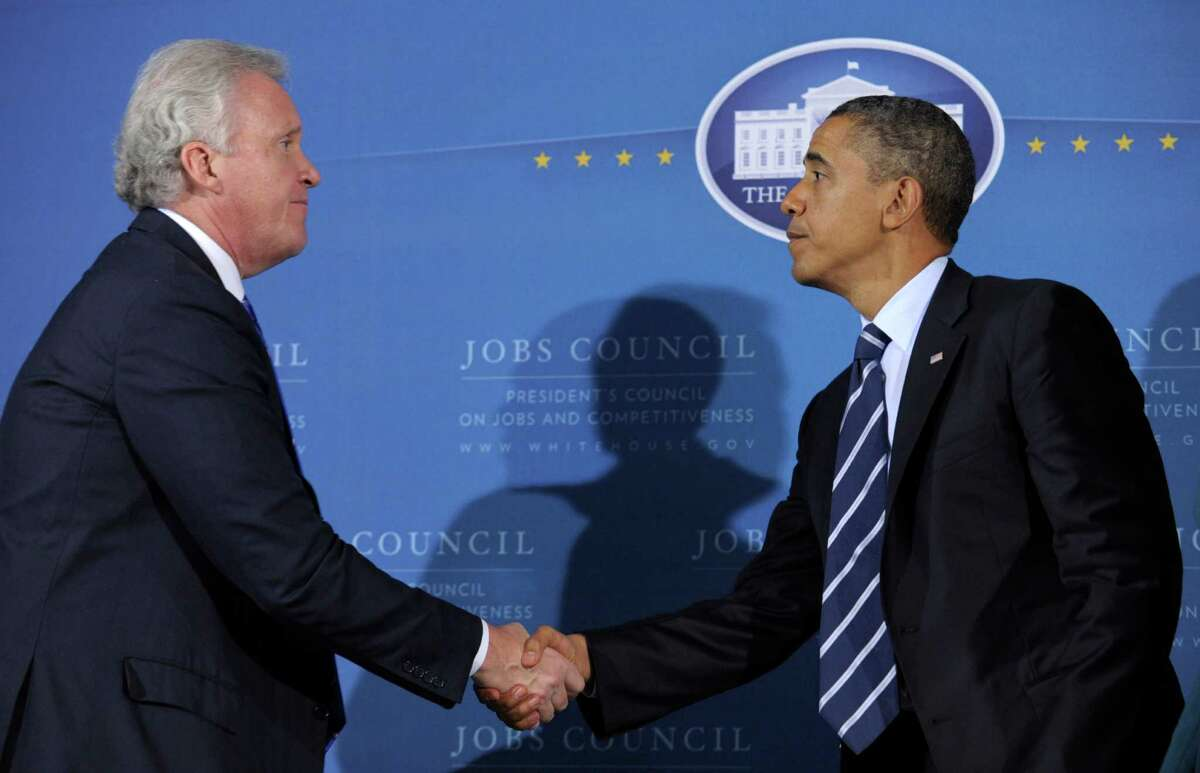 In this file photo from 2011, President Barack Obama shakes hands with General Electric CEO Jeff Immelt during a meeting of the President's Council on Jobs at the International Brotherhood of Electrical Workers (IBEW) Local No. 5 Training Center in Pittsburgh.