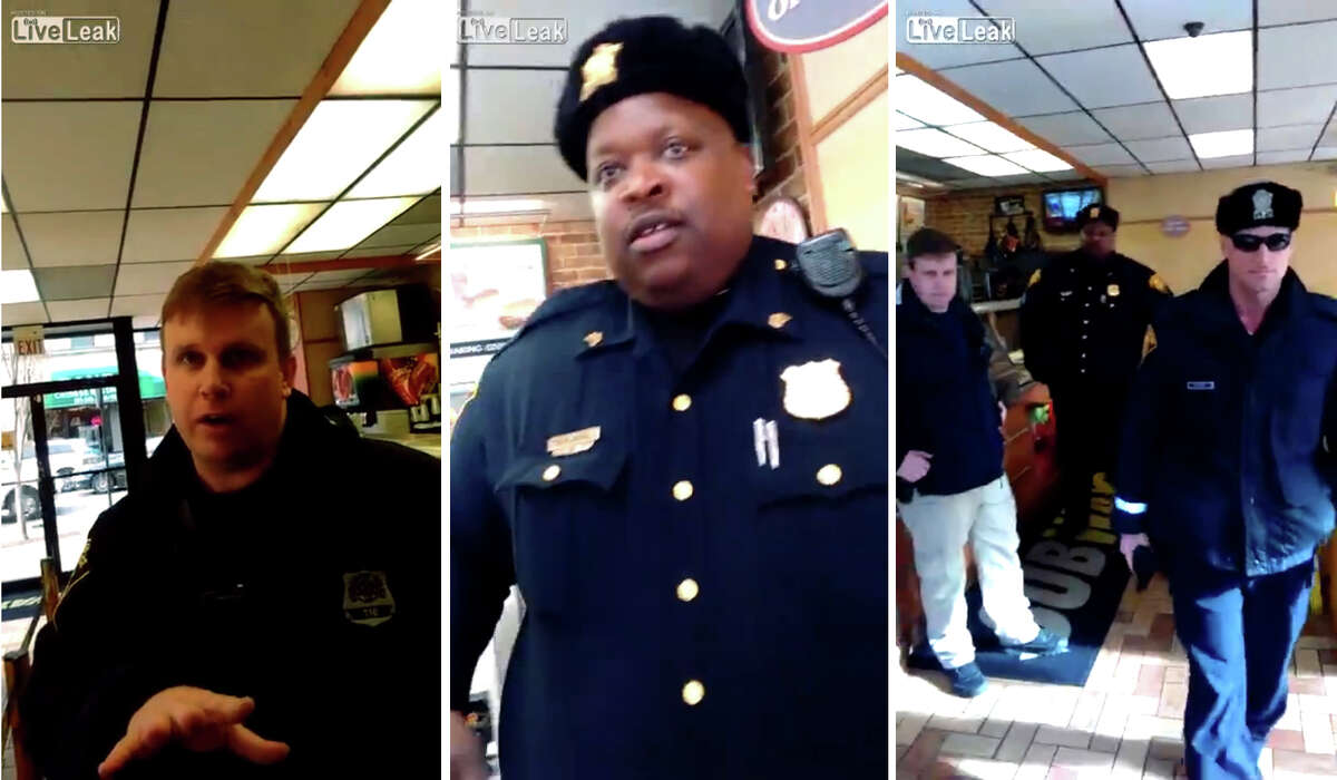 Three scenes from a video recorded by an armed man as he waited in line at the Subway restaurant in downtown Bridgeport show police officers as they confront the man, repeatedly asking him to show them his gun permit.