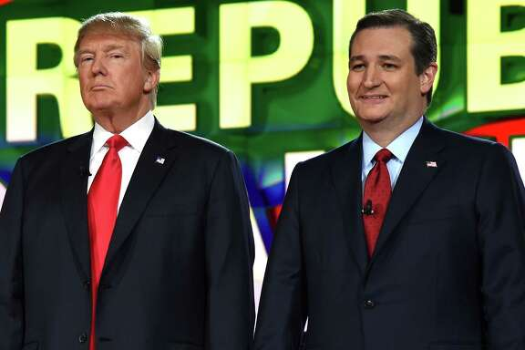 Republican presidential candidates Donald Trump (L) and Sen. Ted Cruz stand on stage during the CNN presidential debate at The Venetian Las Vegas on December 15, 2015 in Las Vegas, Nevada. Thirteen Republican presidential candidates are participating in the fifth set of Republican presidential debates.