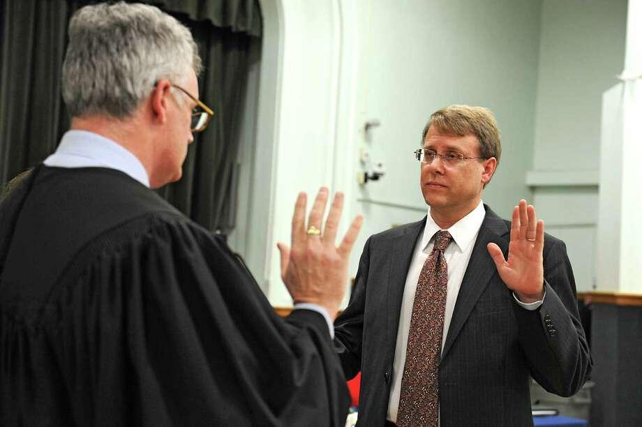 Judge Andy Kirby, left, administers the oath of office to Councilman David VanLuven at Bethlehem Town Hall on Wednesday Jan. 13, 2016 in Delmar, N.Y.  (Lori Van Buren / Times Union) Photo: Lori Van Buren / 10034866A