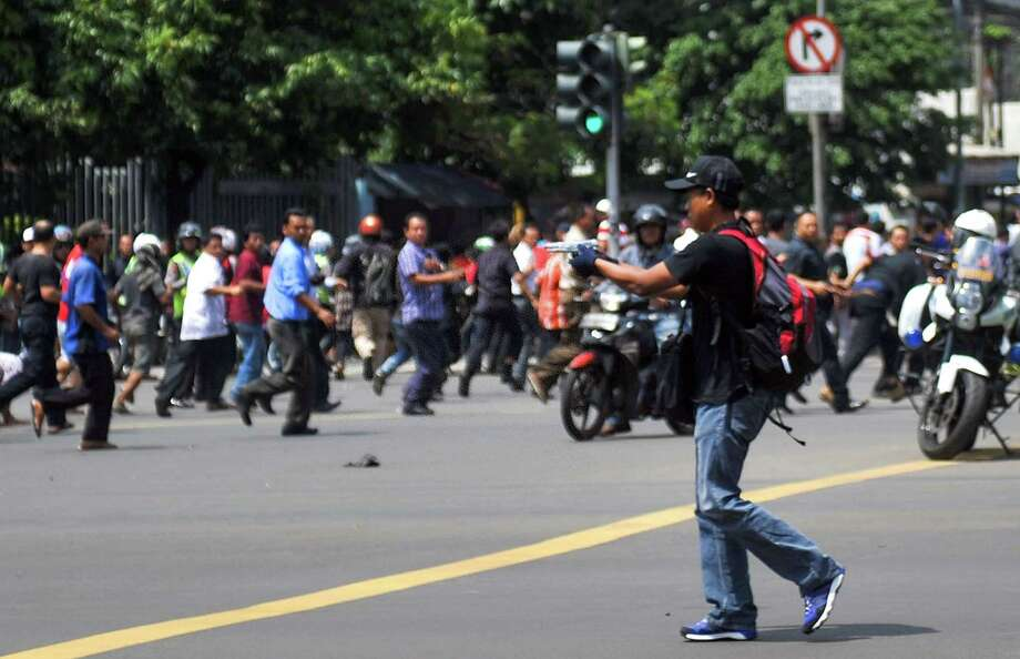 A gunmen points a weapon during deadly attacks in Jakarta, Indonesia. Photo: Xinhua /Getty Images / AFP