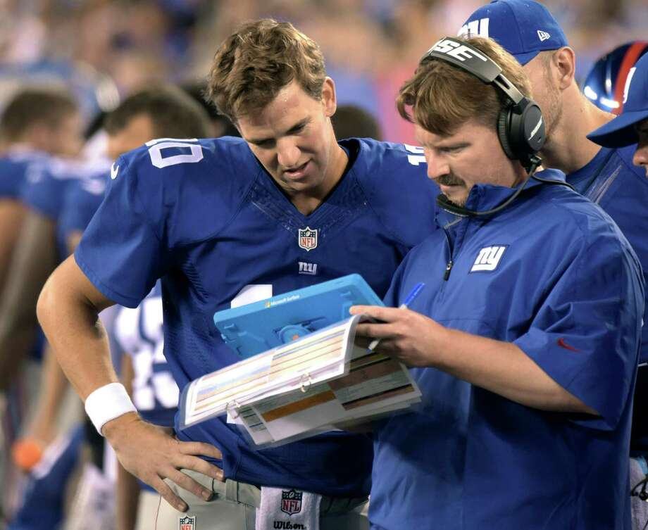 FILE - In this Aug. 22, 2015, file photo, New York Giants offensive coordinator Ben McAdoo confers with quarterbacks Eli Manning, left, and Ryan Nassib, right, during the first half of a preseason NFL football game in East Rutherford, N.J. A person familiar with the decision tells The Associated Press the Giants are hiring offensive coordinator Ben McAdoo as their next head coach. McAdoo, 38, is being given the job a little more than a week after Tom Coughlin stepped down after 12 seasons, the person spoke Wednesday on condition of anonymity because the team has not officially announced the hiring. (AP Photo/Bill Kostroun, File) ORG XMIT: NY172 Photo: Bill Kostroun / FR51951 AP