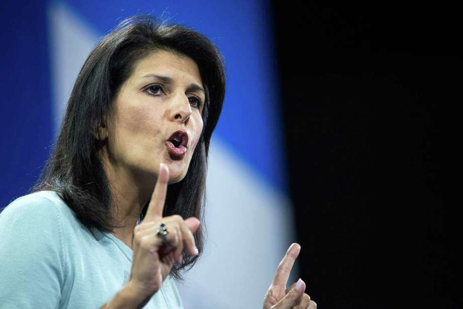 FILE - In  this Jan. 9, 2016 file photo, South Carolina Gov. Nikki Haley speaks to the crowd at the Kemp Forum, Saturday, Jan. 9, 2016, in Columbia, S.C. Two fresh faces in the Republican Party, Haley House Speaker Paul Ryan are offering messages of openness and diversity that could answer the GOP establishment's increasingly desperate search for an antidote to the loud pronouncements of presidential front-runner Donald Trump. (AP Photo/Sean Rayford, File) ORG XMIT: WX202 Photo: Sean Rayford / FR171415 AP