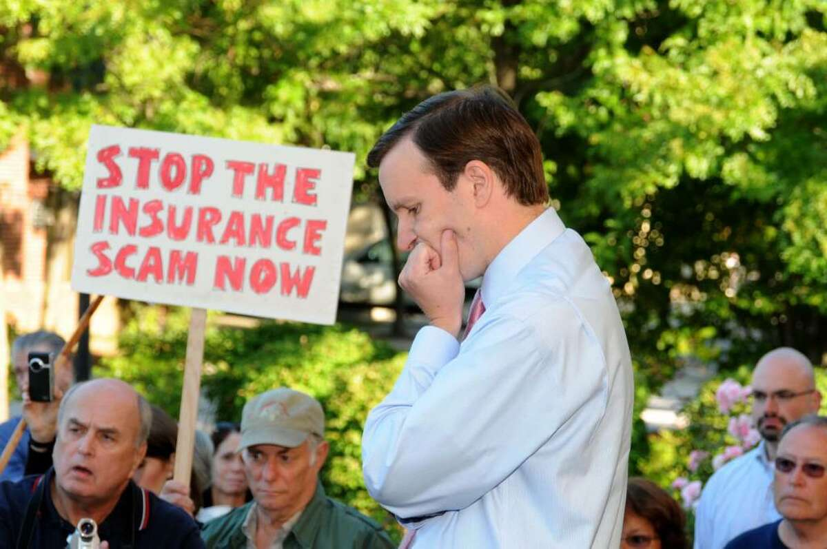 Congressman Chris Murphy listens to a question at an outdoor town hall meeting to discuss health care reform on Wednesday, Sept. 2, 2009, at the Danbury Town Green in Danbury, CT.
