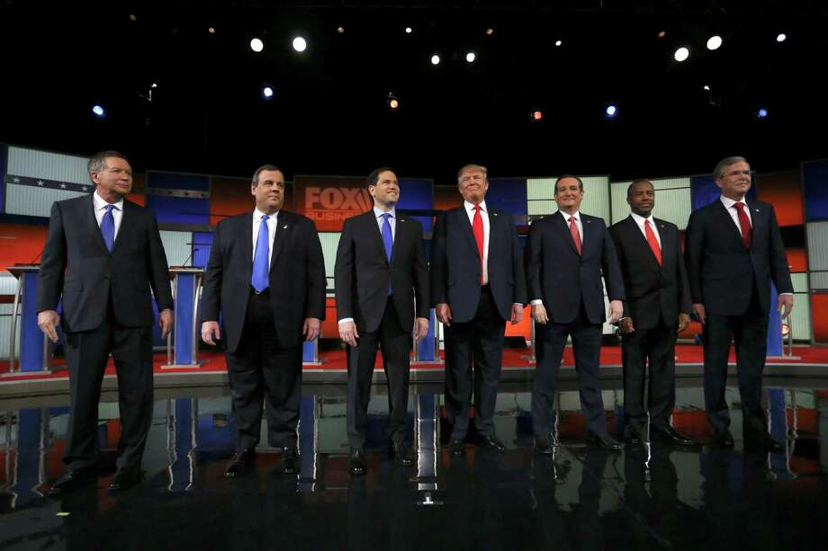 Participants in the Republican presidential primary debate, from left: Gov. John Kasich, Gov. Chris Christie, Sen. Marco Rubio, Donald Trump, Sen. Ted Cruz, Ben Carson and Jeb Bush take the stage at the North Charleston Coliseum in North Charleston, S.C., Jan. 14, 2016. The next-to-last debate before the Iowa caucuses is being moderated by the Fox Business Channel. Photo: ERIC THAYER, New York Times / NYTNS