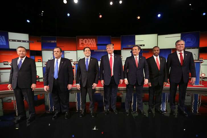 NORTH CHARLESTON, SC - JANUARY 14:  Republican presidential candidates (L-R) Ohio Governor John Kasich, New Jersey Governor Chris Christie, Sen. Marco Rubio (R-FL), Donald Trump, Sen. Ted Cruz (R-TX), Ben Carson and Jeb Bush arrive to participate in the Fox Business Network Republican presidential debate at the North Charleston Coliseum and Performing Arts Center on January 14, 2016 in North Charleston, South Carolina. The sixth Republican debate is held in two parts, one main debate for the top seven candidates, and another for three other candidates lower in the current polls.  (Photo by Andrew Burton/Getty Images)