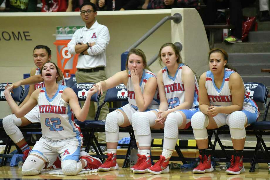 Catherine Granados (42) and Antonian teammates watch from the bench as their teammates fight a losing battle against Incarnate Word during TAPPS girls high school basketball action at the Alamo Convocation Center on Thursday, Jan. 14, 2016. Photo: Billy Calzada, Staff / San Antonio Express-News / San Antonio Express-News