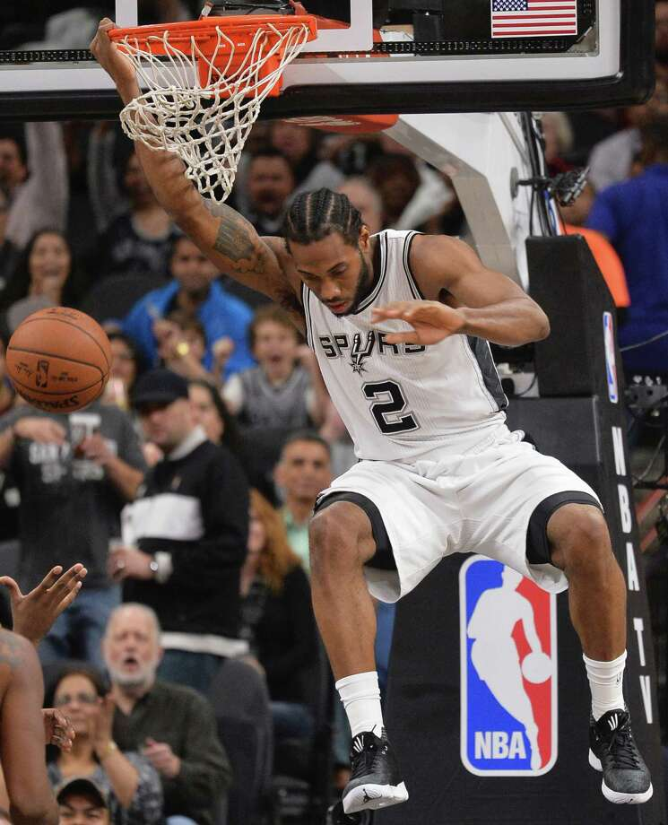 San Antonio Spurs forward Kawhi Leonard dunks during the first half of an NBA basketball game against the Cleveland Cavaliers, Thursday, Jan. 14, 2016, in San Antonio. (AP Photo/Darren Abate) Photo: Darren Abate, Associated Press / FR115 AP