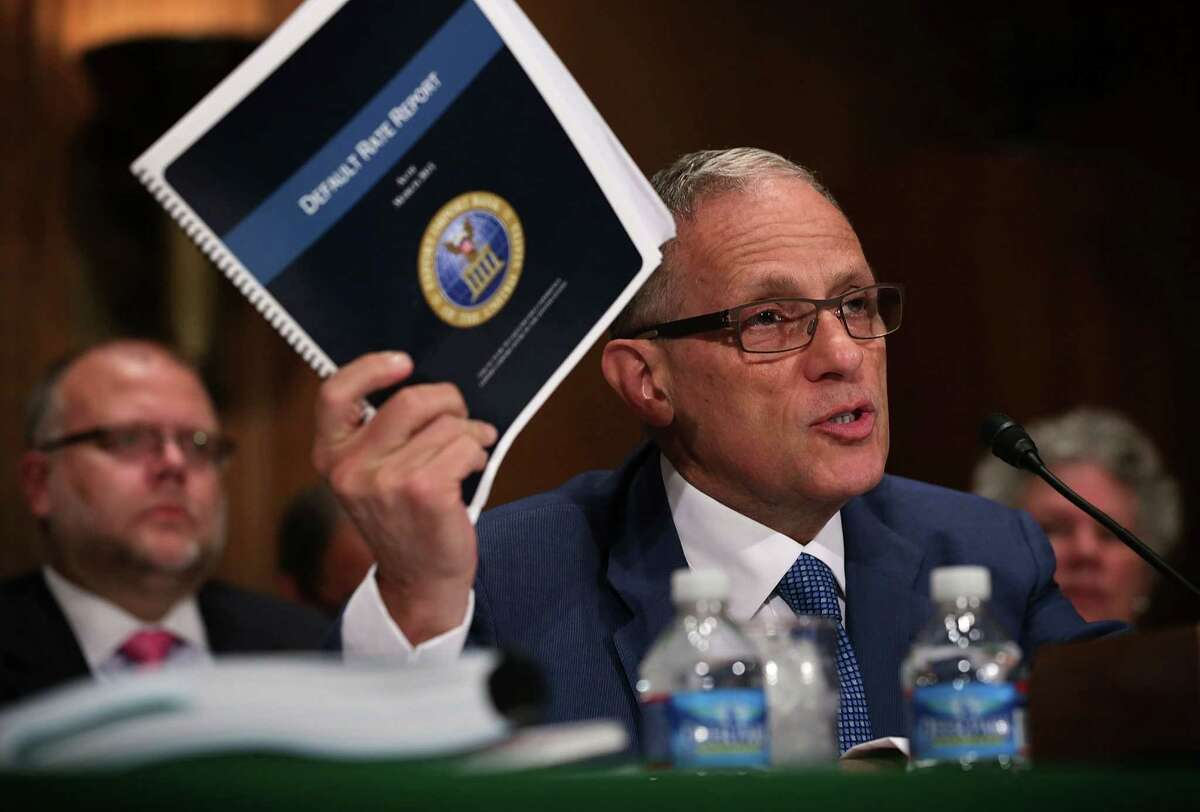 WASHINGTON, DC - JUNE 04: Fred Hochberg, Chairman and President of the Export-Import Bank of the United States holds up a copy of the bank's Default Rate Report as he testifies during a hearing before the Senate Banking, Housing and Urban Affairs Committee June 4, 2015 on Capitol Hill in Washington, DC. The committee held a hearing on