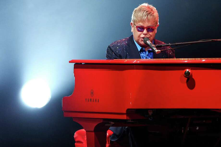 FILE - In this Wednesday, Jan. 13, 2016 file photo, Elton John performs at The Wiltern  in Los Angeles. John didn't just premiere tracks from his new album at his most recent concert, he offered a tribute to his late friend David Bowie. About halfway through John's performance Wednesday night, he shared a story about Bowie, who died earlier this week.  (Photo by Rich Fury/Invision/AP, File) ORG XMIT: CAET862 Photo: Rich Fury / Invision