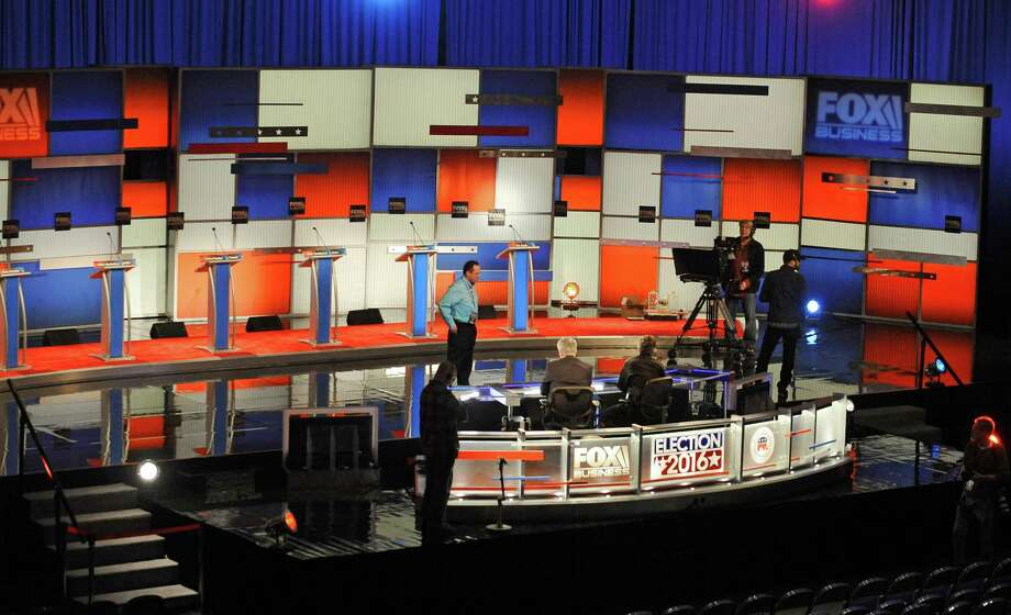 Crew members set the stage at the North Charleston Coliseum, Wednesday, Jan. 13, 2016, in North Charleston, S.C., in advance of Thursday's Fox Business Network Republican presidential debate. (AP Photo/Rainier Ehrhardt) ORG XMIT: SCCB105 Photo: Rainier Ehrhardt / FR155191 AP