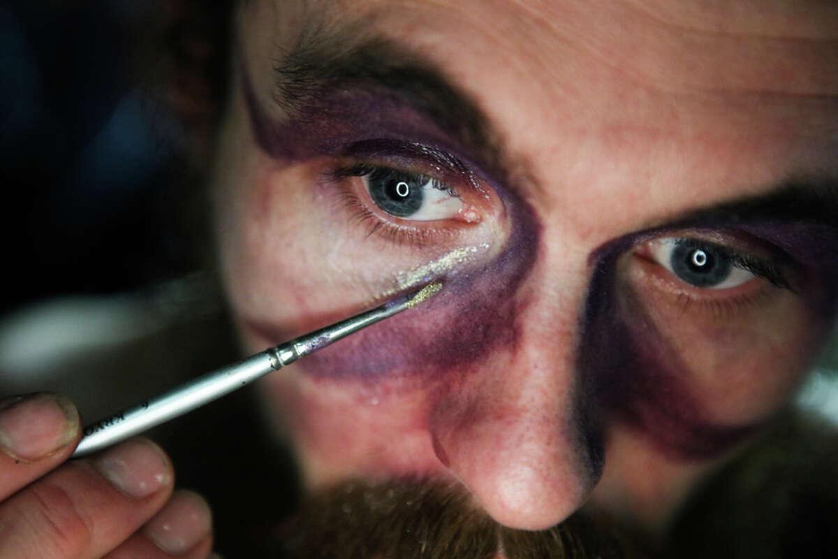 Left: Charles Darius applies makeup.