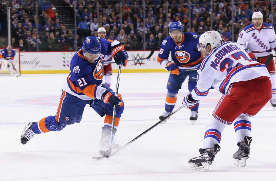 NEW YORK, NY - JANUARY 14: Kyle Okposo #21 of the New York Islanders takes the shot against the New York Rangers during the second period at the Barclays Center on January 14, 2016 in the Brooklyn borough of New York City.  (Photo by Bruce Bennett/Getty Images) ORG XMIT: 574713925 Photo: Bruce Bennett / 2016 Getty Images