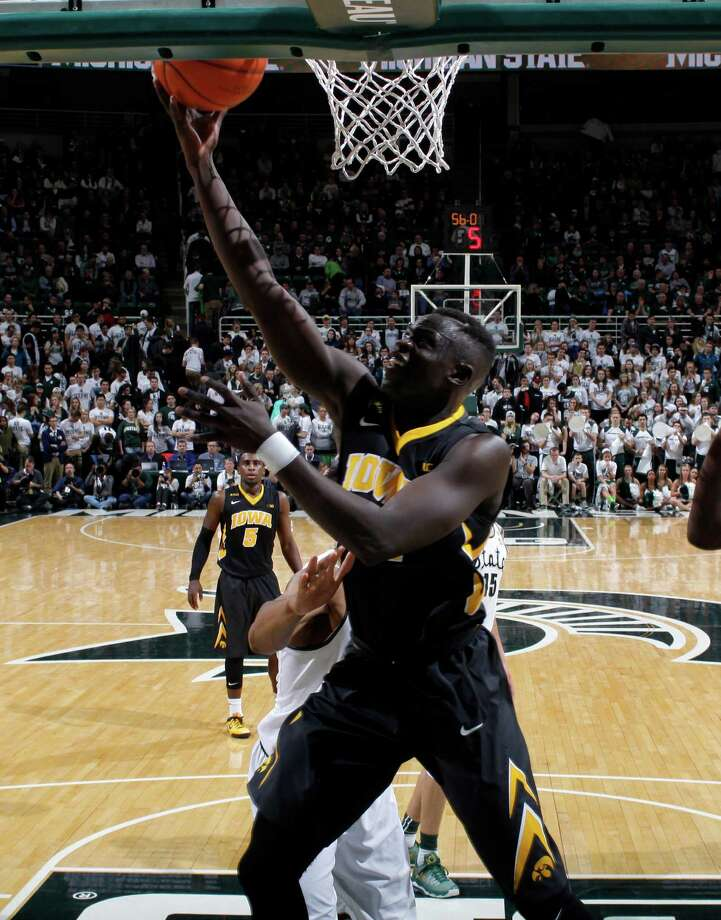 Iowa's Peter Jok puts up a layup under the basket against Michigan State during the second half of an NCAA college basketball game Thursday, Jan. 14, 2016, in East Lansing, Mich. Jok led Iowa with 23 points in a 76-59 win. (AP Photo/Al Goldis) ORG XMIT: ELJ107 Photo: Al Goldis / FR11125 AP