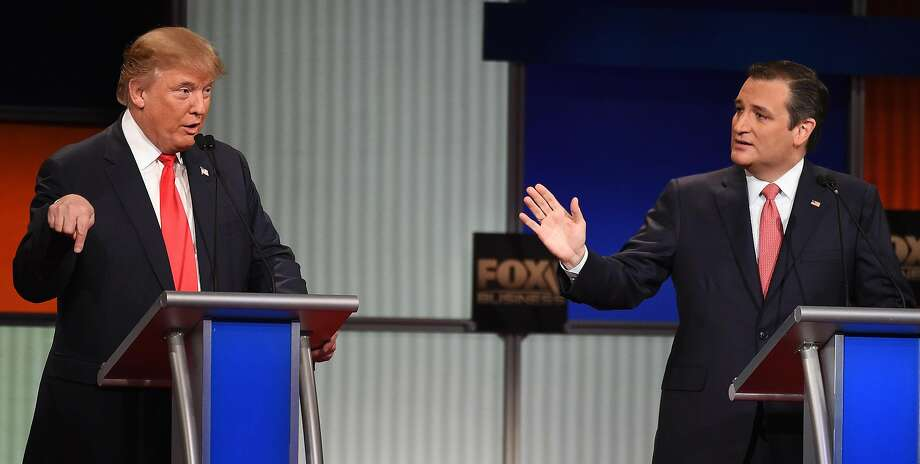 Republican presidential candidate, businessman Donald Trump, left, speaks as Republican presidential candidate, Sen. Ted Cruz, R-Texas, speaks during the Fox Business Network Republican presidential debate at the North Charleston Coliseum, Thursday, Jan. 14, 2016, in North Charleston, S.C. (AP Photo/Rainier Ehrhardt) Photo: Rainier Ehrhardt, Associated Press