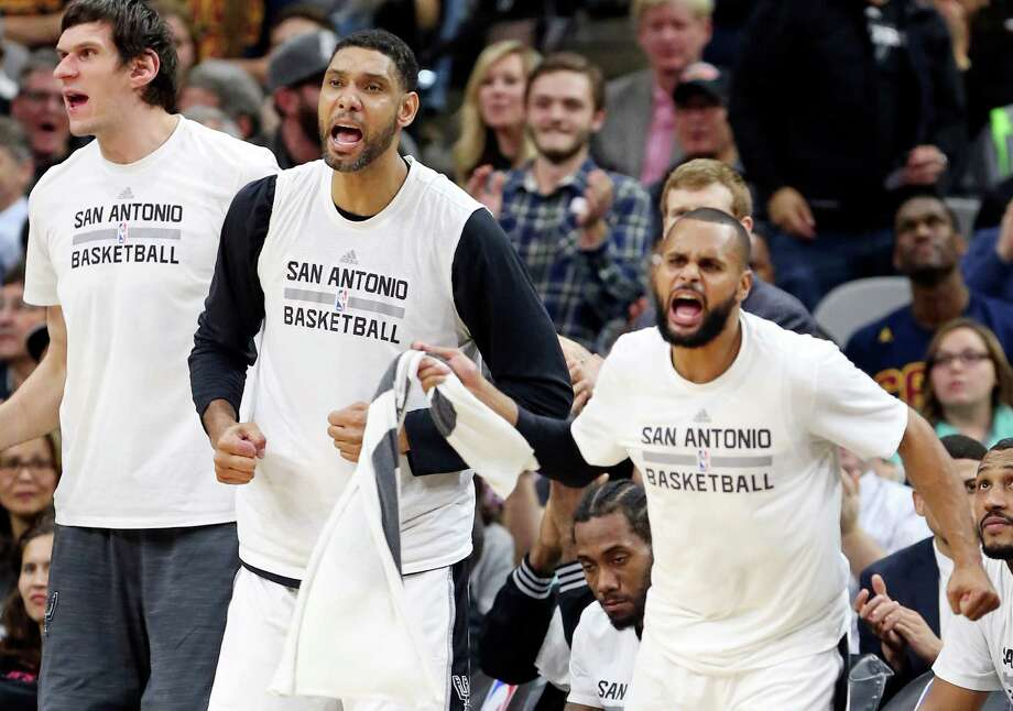 Spurs' Boban Marjanovic, Tim Duncan, and Patty Mills react after a score during second half action against the Cleveland Cavaliers on Jan. 14, 2016 at the AT&T Center. The Spurs won 99-95. Photo: Edward A. Ornelas /San Antonio Express-News / © 2016 San Antonio Express-News
