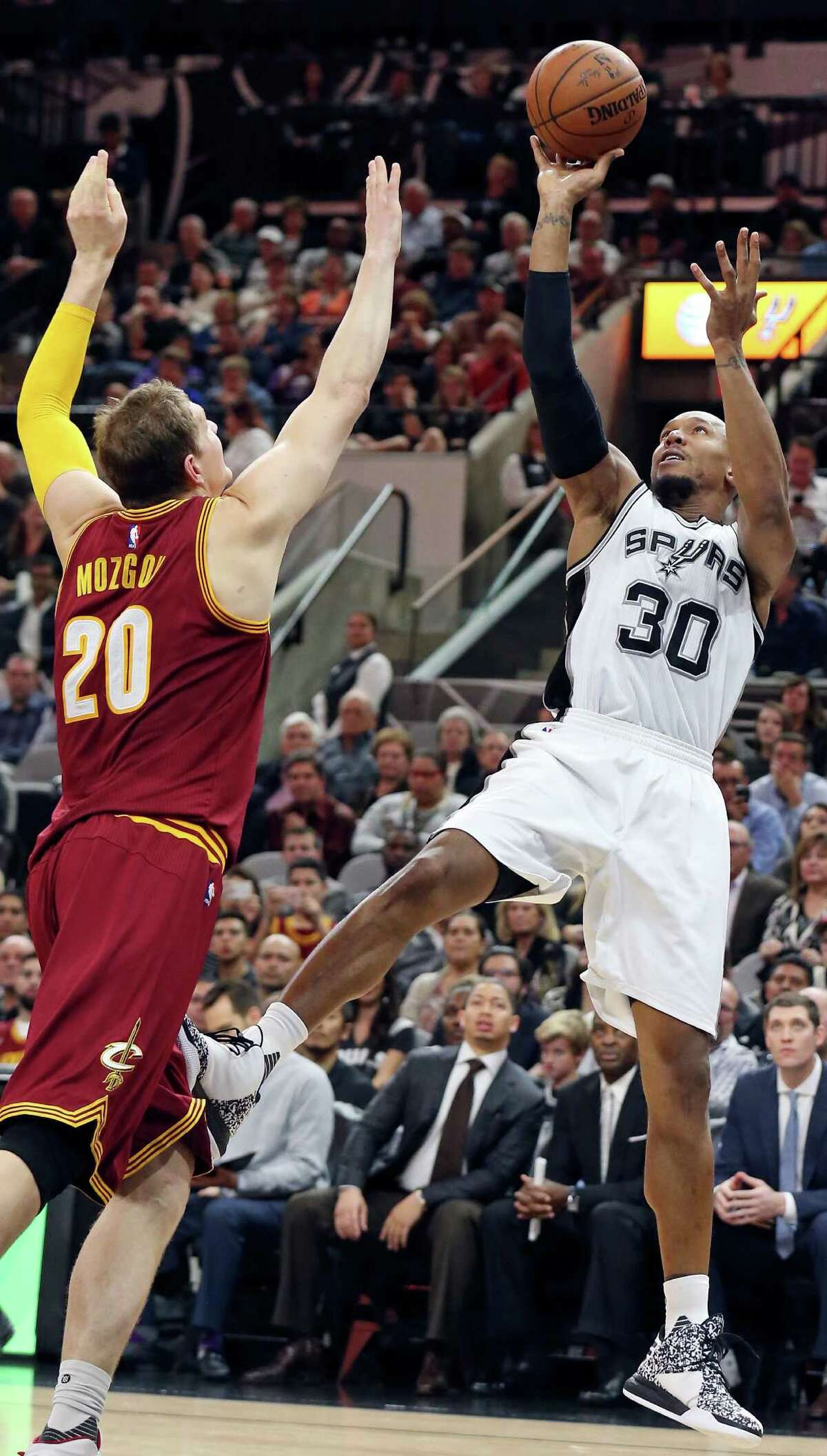 Spurs' David West shoots around the Cleveland Cavaliers' Timofey Mozgov during second half action on Jan. 14, 2016 at the AT&T Center.