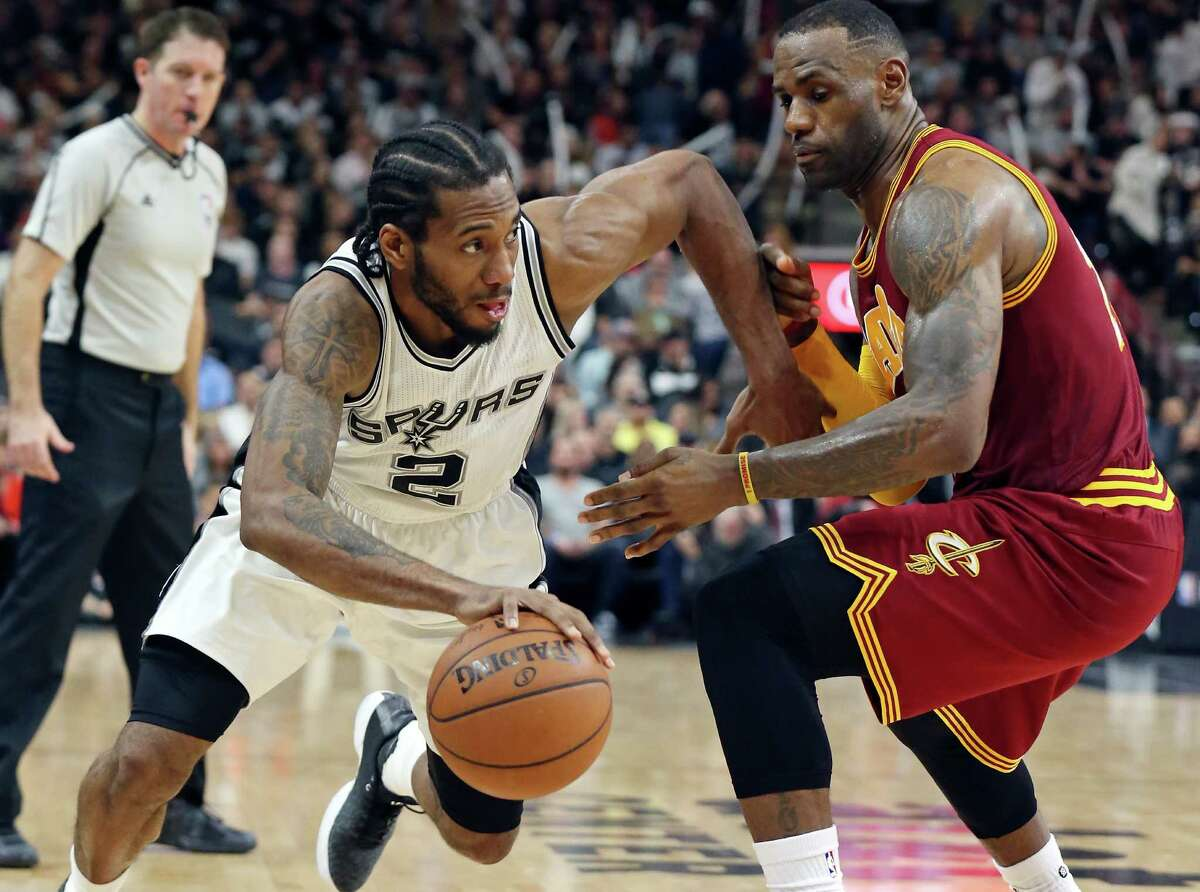 Spurs' Kawhi Leonard looks for room around Cleveland Cavaliers' LeBron James during second half action Jan. 14, 2016 at the AT&T Center. The Spurs won 99-95.