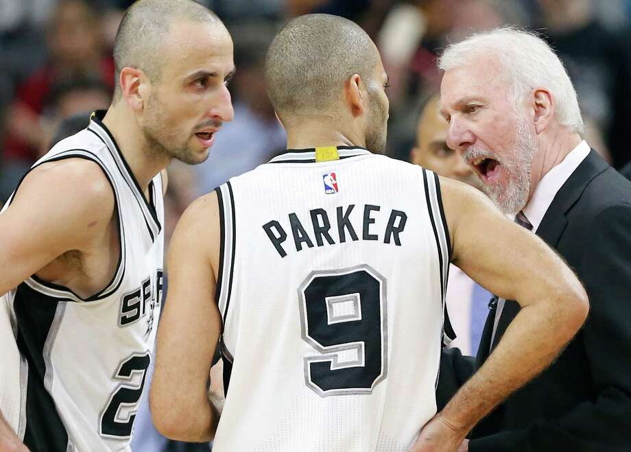 Spurs' Manu Ginobili and Tony Parker talk with head coach Gregg Popovich during second half action against the Cleveland Cavaliers on Jan. 14, 2016 at the AT&T Center. The Spurs won 99-95. Photo: Edward A. Ornelas /San Antonio Express-News / © 2016 San Antonio Express-News