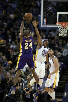 Andre Iguodala (9) defends against a shot by Kobe Bryant (24) in the first half the Golden State Warriors played against the Los Angeles Lakers at Oracle Arena in Oakland, Calif., on Thursday, January 14, 2016.