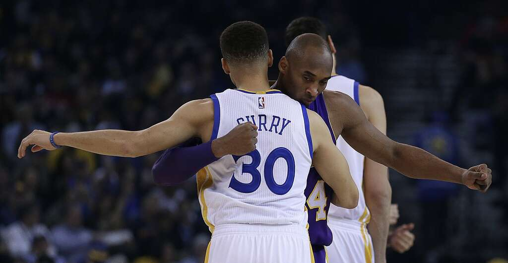 Warriors to watch kobe bryants halftime jersey retirement sfgate los angeles lakers kobe bryant right embraces golden state warriors stephen curry voltagebd Images