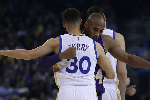 Los Angeles Lakers' Kobe Bryant, right, embraces Golden State Warriors' Stephen Curry (30) prior to an NBA basketball game Thursday, Jan. 14, 2016, in Oakland, Calif. (AP Photo/Ben Margot)