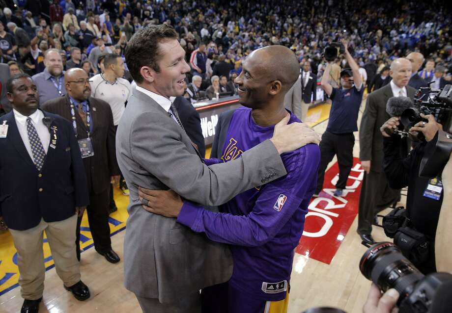 Kobe Bryant (24) hugs Luke Walton, the Warriors interim coach and Kobe's former Lakers teammate after the Golden State Warriors played against the Los Angeles Lakers at Oracle Arena in Oakland, Calif., on Thursday, January 14, 2016. Photo: Carlos Avila Gonzalez, The Chronicle