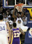 Festus Ezeli (31) dunks in the second half the Golden State Warriors played against the Los Angeles Lakers at Oracle Arena in Oakland, Calif., on Thursday, January 14, 2016.