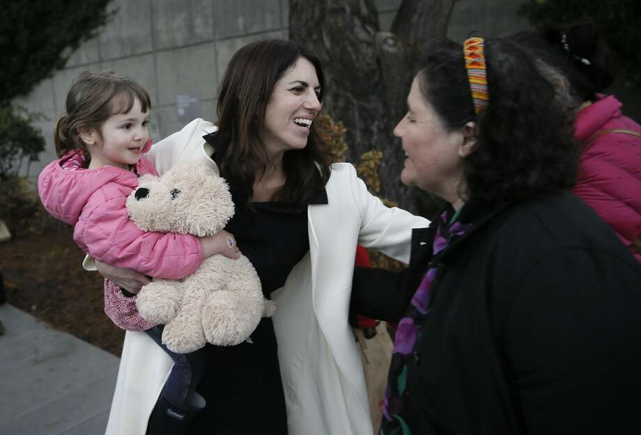 Hillary Ronen with her 3-year-old daughter Maelle Ronen Ugarte greets supporters as she prepares to  announce her candidacy for San Francisco  Supervisor, district 9, in front of St. Luke's Hospital in the Mission in San Francisco, Calif. on Thurs. January 14, 2016. Photo: Michael Macor, The Chronicle