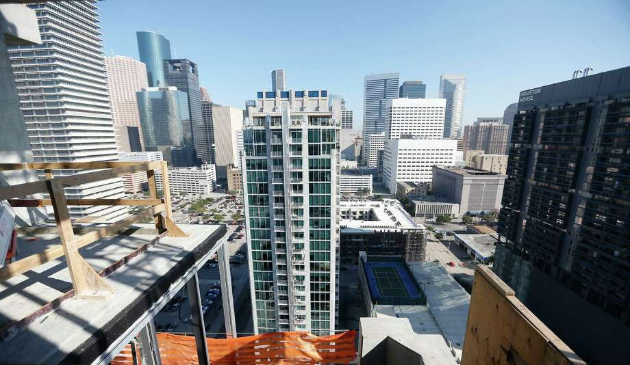 SkyHouse Houston opened last year, and its twin is under construction nearby. Photo: Karen Warren, Staff / © 2015  Houston Chronicle