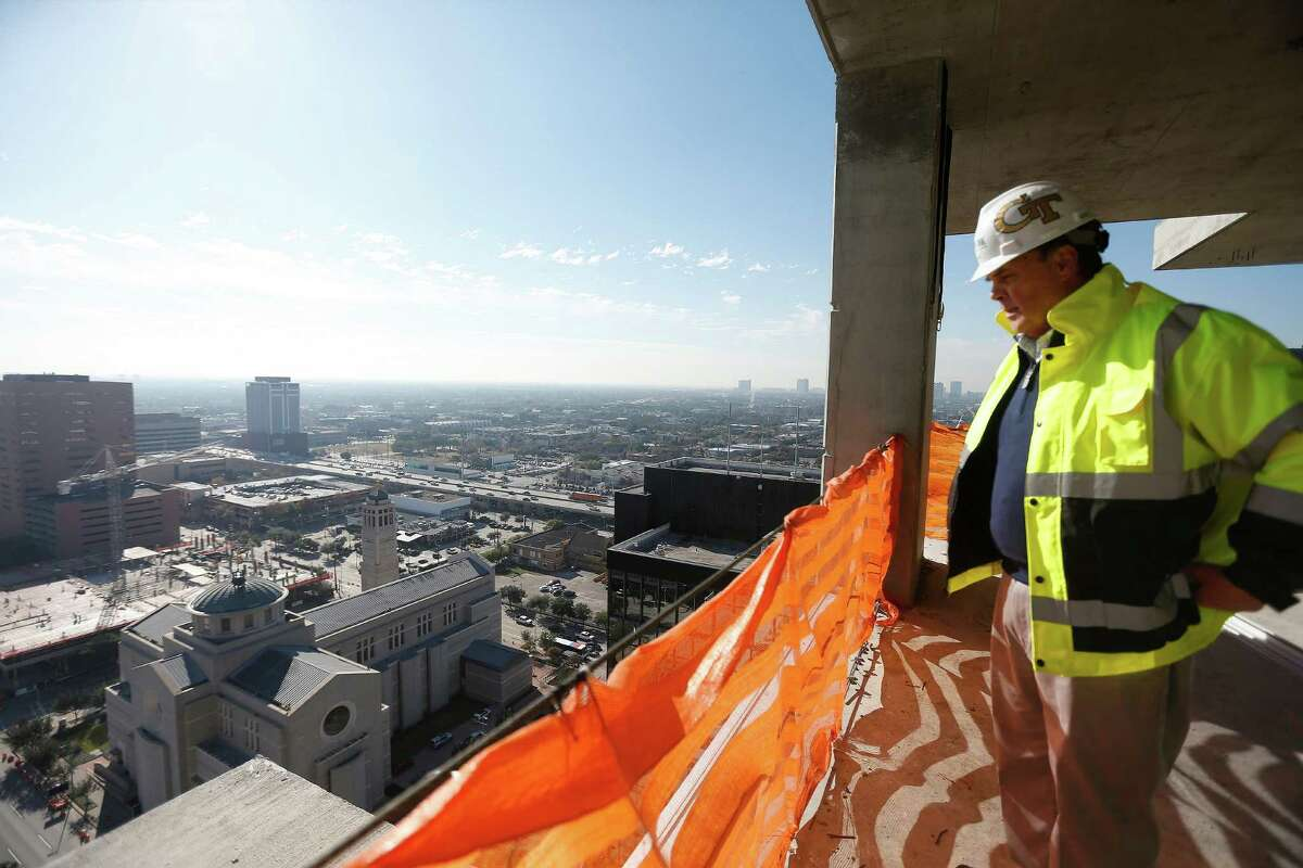 Construction manager Michael Healy is at the top of SkyHouse Main, which is expected to open in the summer. There are 17 SkyHouse apartment communities in the U.S.