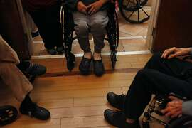 Clients are arranged in a circle in a common room by staff at AgeSong assisted living community Jan. 14, 2015 in San Francisco, Calif. Agesong is one of the communities that Seniorly connects people with.