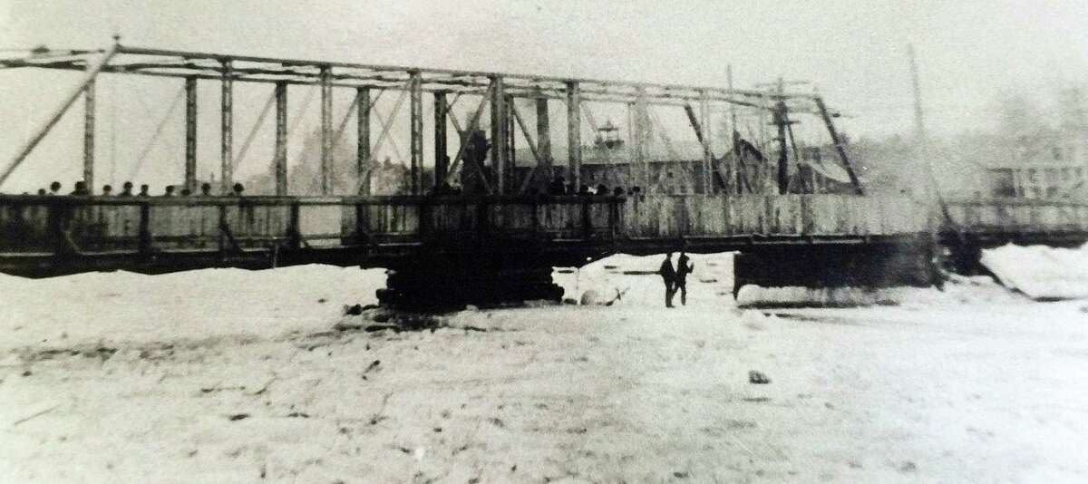 The Bridge Street bridge, spanning a frozen Saugatuck River circa 1900, was built in 1884 -- before the automobile even was invented, points out columnist Arthur Hayes. (From the archives of the Westport Historical Society.)