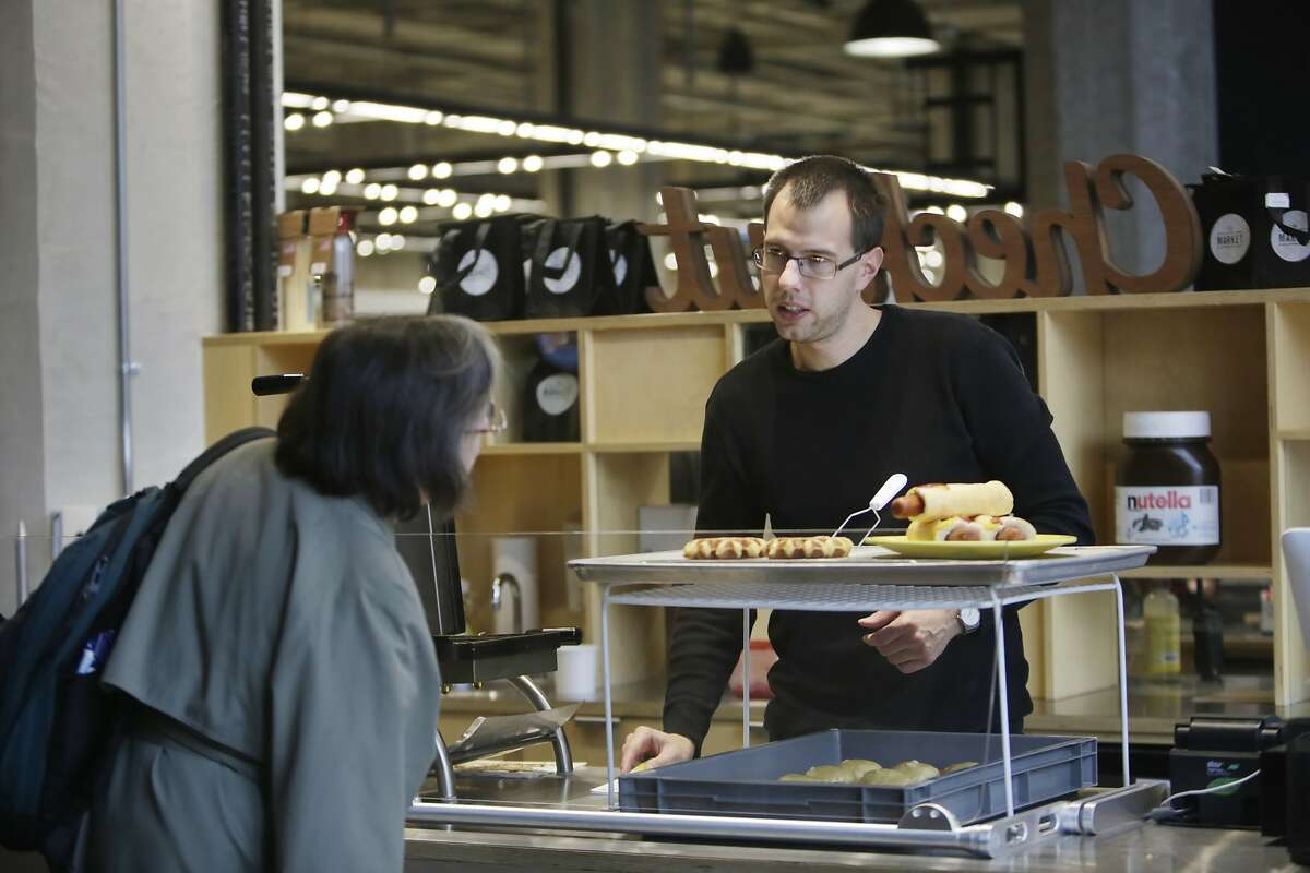 Lukas Bazant, Oui Snack employee, helps a customer at Oui Snack in The Market on Market on Thursday, January 14, 2015 in San Francisco, Calif. Oui Snack started as a temporary pop up and is moving into a permanent space in The Market on Market.