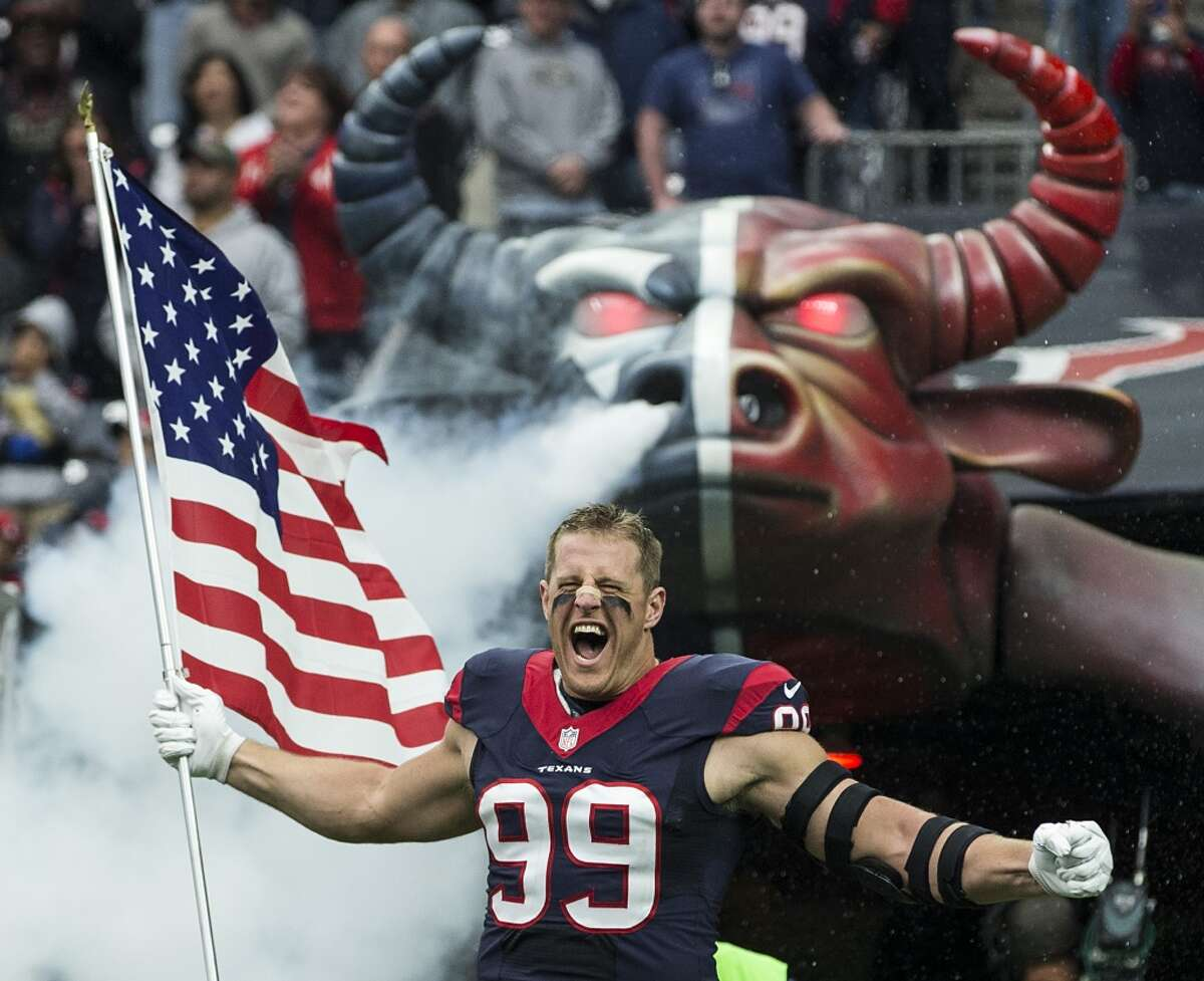 Our photographers put together their best photos from the Texans' 2015-16 season. Houston Texans defensive end J.J. Watt carries a flag as he runs onto the field during pre-game ceremonies before an NFL football game between the Texans and the New York Jets at NRG Stadium on Sunday, Nov. 22, 2015, in Houston. ( Brett Coomer / Houston Chronicle )