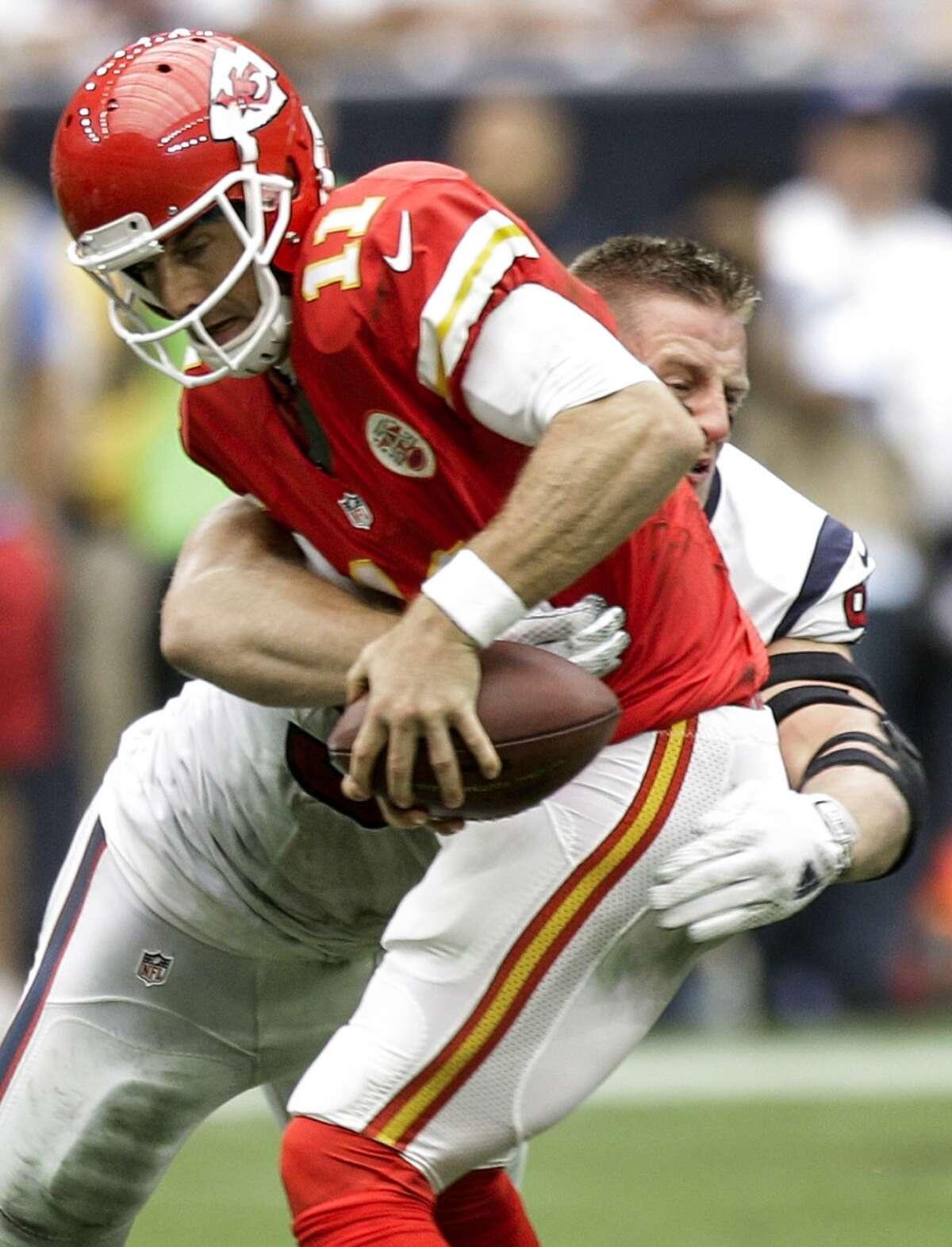 Houston Texans defensive end J.J. Watt (99) sacks Kansas City Chiefs quarterback Alex Smith (11) during the second quarter of an NFL football game at NRG Stadium on Sunday, Sept. 13, 2015, in Houston. ( Brett Coomer / Houston Chronicle )