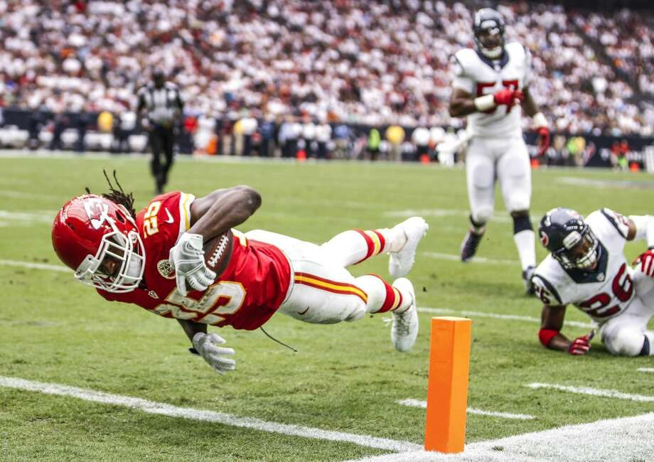 Kansas City Chiefs running back Jamaal Charles (25) dives into the end zone after breaking away from Houston Texans defensive back Rahim Moore (26) for a 7-yard touchdown reception during the second quarter of an NFL football game at NRG Stadium on Sunday, Sept. 13, 2015, in Houston. ( Brett Coomer / Houston Chronicle ) Photo: Brett Coomer, Houston Chronicle