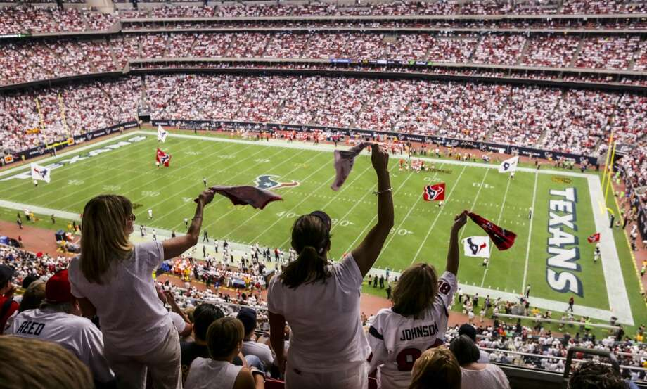 Madonna Pool, left, Shannon Reynold and Lorie Stubbs stand and cheer during a Texans game on Sept. 13, 2015. The Wi-Fi system going up at NRG Stadium will cost in excess of $6 million. Photo: Jon Shapley, Houston Chronicle