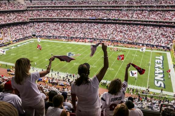 Madonna Pool, left to right, Shannon Reynold and Lorie Stubbs stand and cheer following a touchdown by the Houston Texans during the first half of an NFL game between the Houston Texans and the Kansas City Chiefs, at NRG Stadium, Sunday, Sept. 13, 2015, in Houston.  ( Jon Shapley / Houston Chronicle )