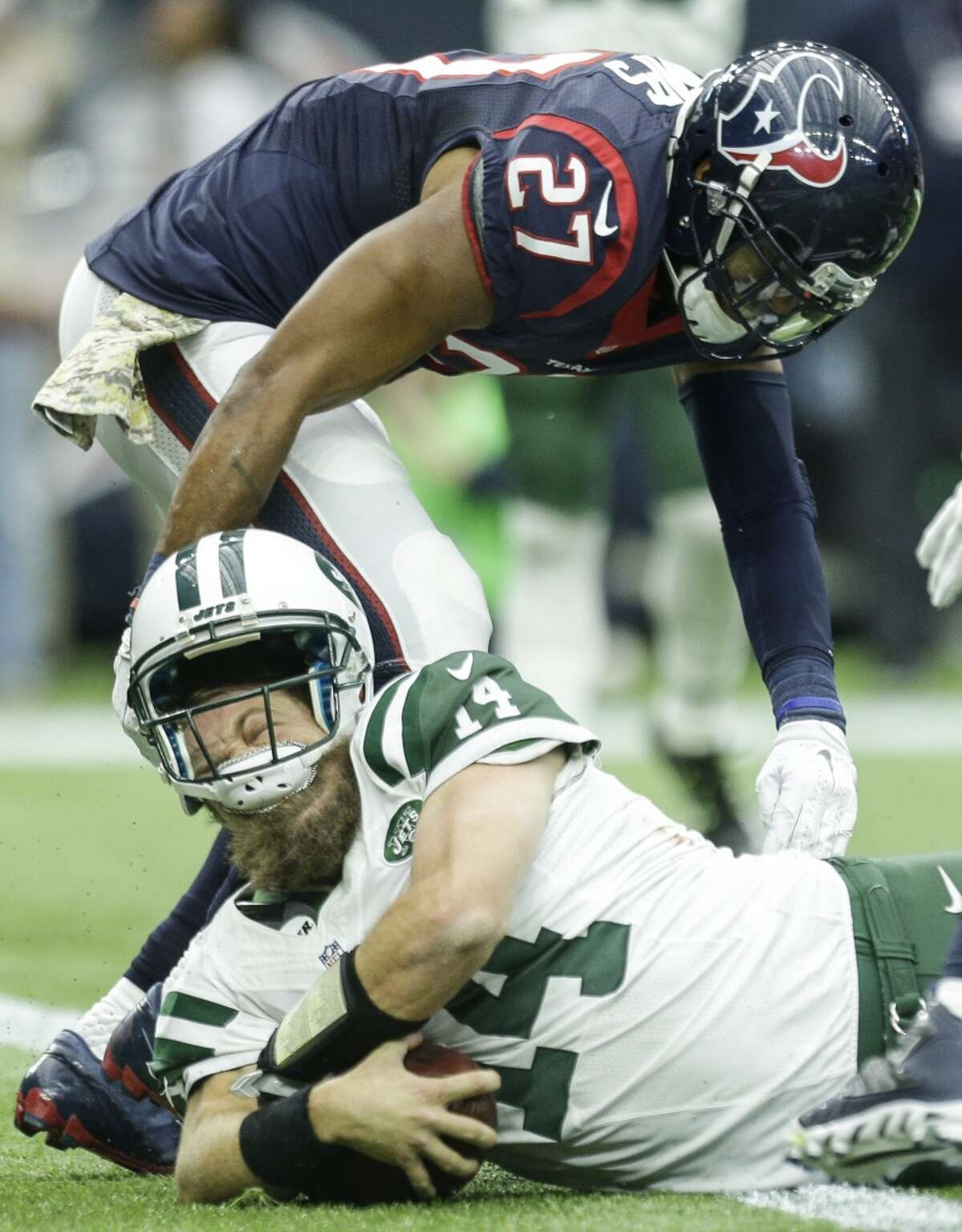 New York Jets quarterback Ryan Fitzpatrick (14) is hit by Houston Texans strong safety Quintin Demps (27) as he dives across the goal line for a 6-yard touchdown run during the fourth quarter of an NFL football game at NRG Stadium on Sunday, Nov. 22, 2015, in Houston. ( Brett Coomer / Houston Chronicle )